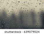 rain drops on window surface... | Shutterstock . vector #639079024