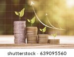 tree growing on coins stack... | Shutterstock . vector #639095560