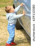 the kid is studying the car | Shutterstock . vector #639110380