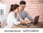 smiling young couple looking at ... | Shutterstock . vector #639110824