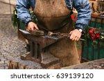 Blacksmith Working Metal With ...