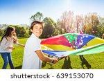 happy boy holding parachute...   Shutterstock . vector #639153070