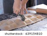 woman making ravioli on table | Shutterstock . vector #639154810