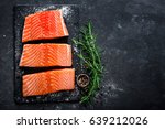 Raw Salmon Filet On Dark Slate...