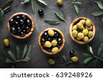 black and green olives in... | Shutterstock . vector #639248926