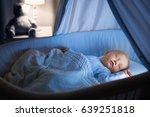 adorable baby drinking milk in... | Shutterstock . vector #639251818