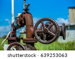 rusty pipes  wheel and valves   ... | Shutterstock . vector #639253063