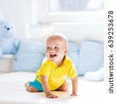 baby playing on parents bed.... | Shutterstock . vector #639253678