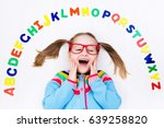 happy preschool child learning... | Shutterstock . vector #639258820