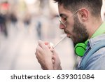 man pulls a cigarette from the... | Shutterstock . vector #639301084