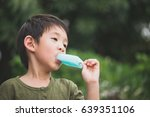 cute asian child eating blue... | Shutterstock . vector #639351106