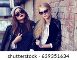 fashion portrait of two young... | Shutterstock . vector #639351634