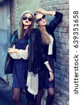 fashion portrait of two young... | Shutterstock . vector #639351658