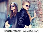 fashion portrait of two young... | Shutterstock . vector #639351664