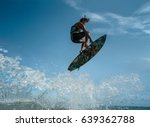a kite surfer rides the waves | Shutterstock . vector #639362788