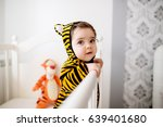 cute baby wearing a tiny tiger... | Shutterstock . vector #639401680