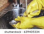 washing dishes. hands in yellow ... | Shutterstock . vector #639405334