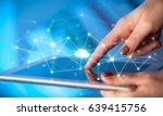 female hands touching tablet...   Shutterstock . vector #639415756
