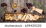 Cheese Selection On Wooden...