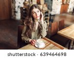 pretty girl talk on the phone... | Shutterstock . vector #639464698