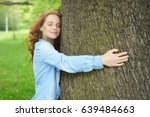 Contented Young Woman Hugging ...