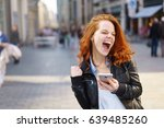 exuberant young woman cheering... | Shutterstock . vector #639485260