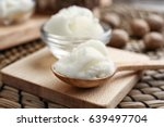 Small photo of Shea butter in spoon and bowl on board, close up