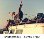 women sitting on the roof of... | Shutterstock . vector #639514780