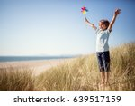 boy playing with windmill in... | Shutterstock . vector #639517159