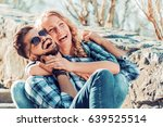 happy young couple hugging and... | Shutterstock . vector #639525514