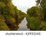 river canal surrounded by lush... | Shutterstock . vector #63953140