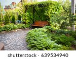 bench in home garden. natural... | Shutterstock . vector #639534940
