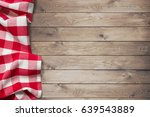 red picnic tablecloth on wood... | Shutterstock . vector #639543889