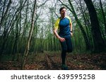 trail runner man training in... | Shutterstock . vector #639595258