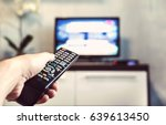the man with the remote control ... | Shutterstock . vector #639613450
