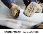 the worker makes the sladding... | Shutterstock . vector #639620788