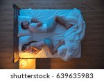 the man and woman sleeping on... | Shutterstock . vector #639635983