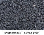 Black Pebble As A Background.