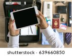 Small photo of businessman organization on tablet for travel top view
