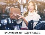 laughing female choosing bag... | Shutterstock . vector #639673618