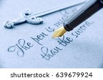 """Small photo of Fountain pen and swords on a paper printed with proverb """"The pen is mightier than the sword"""". This phrase is a metonymic adage, indicating that a journalist can report lie or truth using only a pen."""