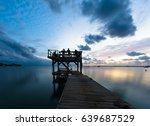 people watching the sunset on... | Shutterstock . vector #639687529