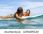 two beautiful sexy surfing girl ... | Shutterstock . vector #639689620