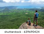 man and woman standing on cliff'... | Shutterstock . vector #639690424