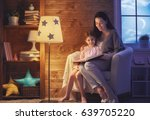 family reading bedtime. pretty... | Shutterstock . vector #639705220