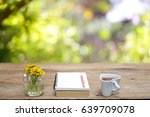 tea and book with flower  | Shutterstock . vector #639709078