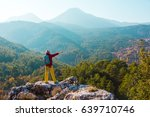 person staying on top of rock... | Shutterstock . vector #639710746