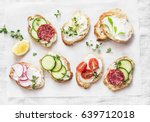 variety of mini sandwiches with ... | Shutterstock . vector #639712018