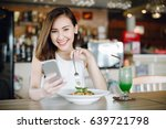 young asia woman eating... | Shutterstock . vector #639721798