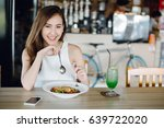 young asia woman eating... | Shutterstock . vector #639722020